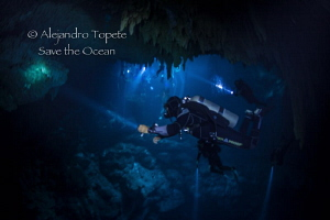 Divers in the Pit, Cenote Pit, Playa del Carmen México by Alejandro Topete