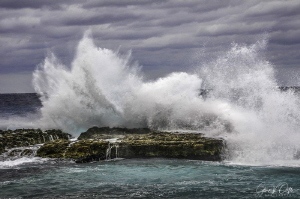 A large wave pounds Northwest Point in Grand Cayman. by Glenn Ostle