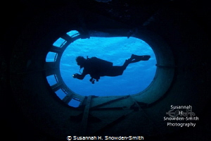 """""""Smokestack Silhouette"""" - A diver is framed within the sm... by Susannah H. Snowden-Smith"""