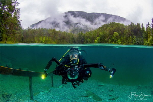 Diver at the Samaranger lake, Austria. by Filip Staes