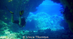 My dive buddy exiting the swim through cave systems at St... by Vince Thornton