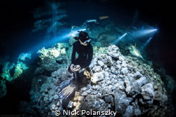 Freediver in Cenote Tajma-ha by Nick Polanszky