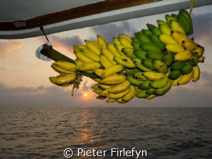 Sunset Indian Ocean on liveaboard by Pieter Firlefyn