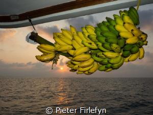 Sunset Indian Ocean on liveaboard by Pieter Firlefyn