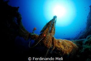 Abandoned fishing net by Ferdinando Meli