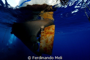 Diving boat from below... by Ferdinando Meli