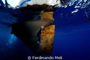 Diving boat from below... by Ferdinando Meli
