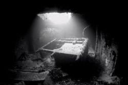 "Overtuned desk inside the wreck of the ""Pietermaritzburg""... by Jean Tresfon"