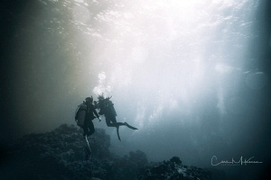 Divers at Hoovers Pinnacle. by Chris Mckenna
