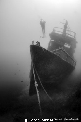 Old fishing boat by Caner Candemir