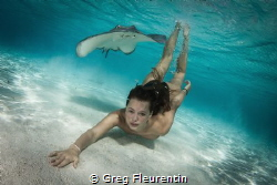In the lagoon of Moorea we used to swim with the sting ra... by Greg Fleurentin