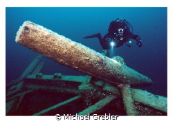 Diver at the starboard anchor of the Arabia lost near Tob... by Michael Grebler