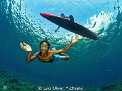 nice to meet you children of local fishermen jumped unde... by Lars Oliver Michaelis