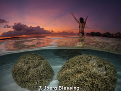 Sunset on a calm evening in Maldives.. by Joerg Blessing