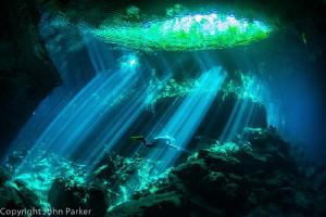 Cenote light show by John Parker