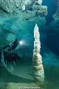 stalagmite with diver, cave diving, Mexico by Susanna Randazzo