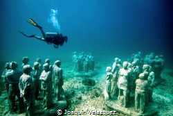 The underwater museum of art in Cancun, better known as M... by Joaquin Velazquez