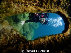 Diver exploring the wreck of a salvage barge, the Michiga... by David Gilchrist