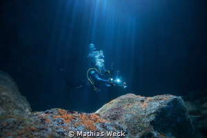 Diver in Urseling Cave / São Jorge / Azores by Mathias Weck