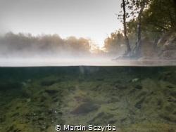 sun rise over foggy lake by Martin Sczyrba