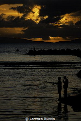 The sunset and the fishermen by Lorenzo Buccio