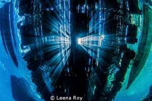 Under the pier by Leena Roy