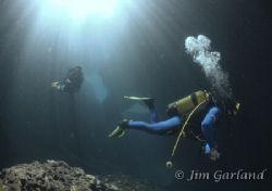 Dive leading cave style. by Jim Garland