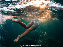 Swimming under Mediterranean sunset by Rune Rasmussen
