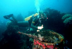 'SANKISAN' Diver checks deck gun ammo on Sankisan Maru - ... by Rick Tegeler