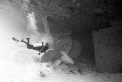 Pam checking out sand erosion at 145' under the Spiegel G... by Michael Salcito