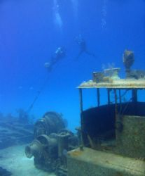 """Divers ascend the stern line of the """"Doc Polson"""" wreck, G... by Brian Mayes"""