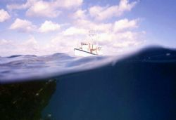 'UH-OH!' Ship headed for the reef - blue hole, Honduras. ... by Rick Tegeler