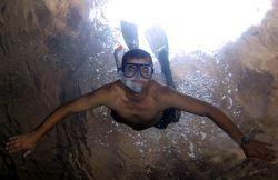 Rambo - duck dive in natural cavern. by John M Akar