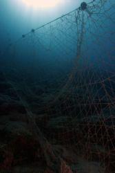 Net wall - discarded net on a reef in Turkey. thankfully ... by John M Akar