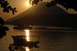 Sun setting behind Manado Tua.Shot taken from Bunaken. D7... by Frankie Tsen
