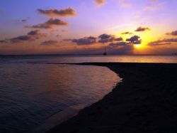 Sunset from the south beach of South Water Cay. by Martin Spragg