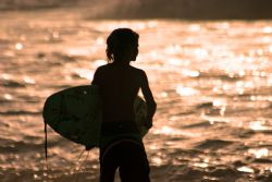 Little Surfer. This kid was out surfing Pipeline on a day... by Mathew Cook