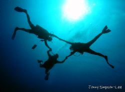 I simply can't resist taking silhouette shots of divers! ... by Jonny Simpson-Lee