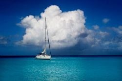 Sailboat in the Kwaj Lagoon, taken From Bigej. by Lee Craker