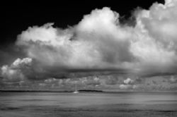 Gathering Storm. A sailboat in the Kwajalein Lagoon by Lee Craker