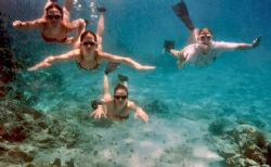 This is an old photo of my wife and kids snorkeling in St... by David Heidemann