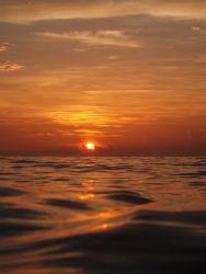 Orange sunset in West Bay by Carlos Valenzuela