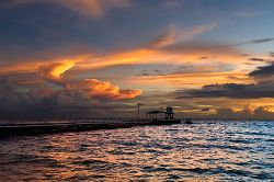 Third Island Pier. View of Sunset from Eniburr Island. by Lee Craker