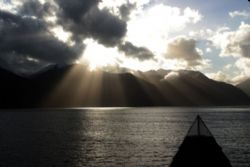Sunshine after the rain. Patagonian fjord Chile by David Thompson