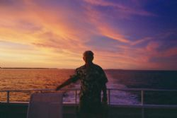 Sunset aboard Tahiti Aggressor. Purfect end to a great da... by Marylin Batt