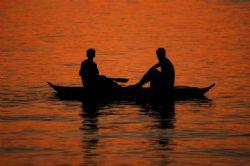 dusk fishing in Anilao, Batangas. by Peri Paleracio