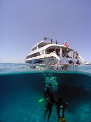 Another days diving. Afloat the Great Barrier Reef by Joshua Miles