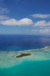 Aerial view of Aitutaki lagoon, Cook Islands by Richard Smith