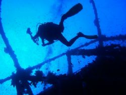 one of my diveing pals hovering over wreck southern red s... by Matt Andrew