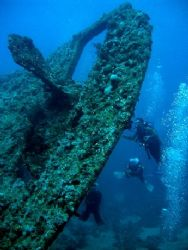The famous Thistelgorm wreck and three fellow divers. Thi... by Steven Withofs